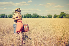 Romantic young couple with old suitcase hugging in Royalty Free Stock Image