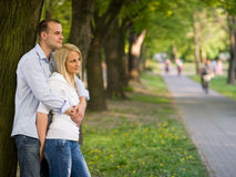 Romantic young couple at the park. Royalty Free Stock Image