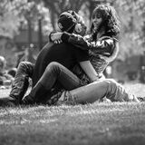 Romantic young couple in park Stock Image