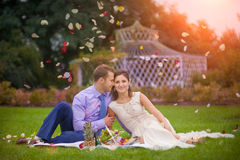 Romantic young couple picnic. Together in the summer park Stock Photos