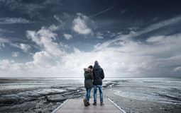 Romantic young couple on a pier stock photography