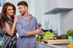 Romantic young couple preparing dinner Royalty Free Stock Photos