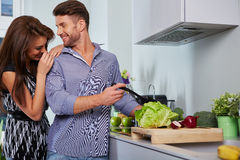 Romantic young couple preparing dinner Royalty Free Stock Photography