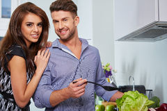 Romantic young couple preparing dinner Stock Photos