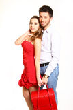 Romantic young couple with a red bag isolated on white backgroun Royalty Free Stock Photography