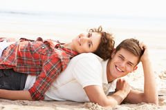 Romantic Young Couple Relaxing On Beach Royalty Free Stock Photo