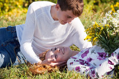 Romantic young couple relaxing outdoors Stock Image
