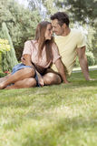 Romantic young couple relaxing in park Royalty Free Stock Photo