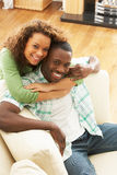 Romantic Young Couple Relaxing Sitting On Sofa Stock Photos