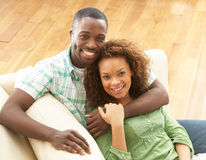 Romantic Young Couple Relaxing Sitting On Sofa Stock Images