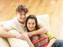 Romantic Young Couple Relaxing Sitting On Sofa Royalty Free Stock Images