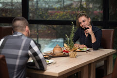 Romantic Young Couple At Restaurant Table Toasting Stock Photos