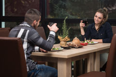 Romantic Young Couple At Restaurant Table Toasting Royalty Free Stock Image