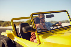 Romantic young couple on road trip Stock Images