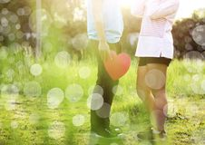 Romantic Young Couple In Love. Romantic young couple showing love and care at the park,valentines day** Note: Slight blurriness Royalty Free Stock Photo