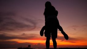 Romantic young couple silhouette dancing spinning around on a amazing sunset. HD Slow Motion. Phangan, Thailand. Romantic Young Couple Silhouette Dancing stock video