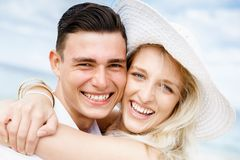 Romantic young couple sitting on the beach Stock Photography