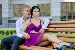 Romantic young couple sitting on bench Royalty Free Stock Images