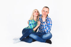 Romantic young couple sitting on floor. Royalty Free Stock Photo
