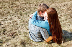 Romantic young couple sitting together Stock Photography
