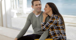Romantic young couple sitting watching Royalty Free Stock Photography