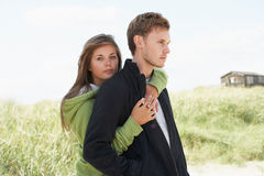 Romantic Young Couple Standing By Dunes Stock Photography