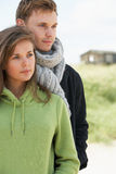 Romantic Young Couple Standing By Dunes Royalty Free Stock Photo