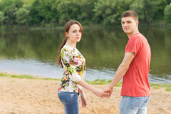 Romantic young couple standing hand in hand Royalty Free Stock Photo