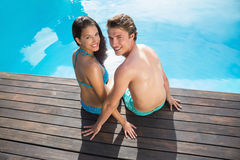 Romantic young couple by swimming pool on a sunny day Royalty Free Stock Photo