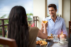 Romantic young couple at table toasting. Dinner on the balcony Royalty Free Stock Image