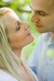 Romantic young couple about to kiss. Royalty Free Stock Image