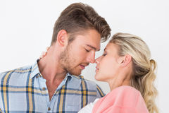 Romantic young couple about to kiss Stock Photos