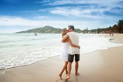Romantic young couple together outdoors on summer day.Caucasian. Couple enjoying the beach view.Enjoy time together,lovely couple on the beach,kissing lops Royalty Free Stock Photo