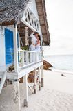 Romantic young couple in tropical beach house Stock Image