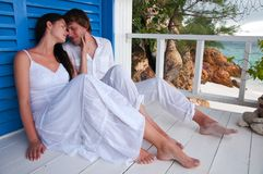 Romantic young couple in tropical beach house Stock Photo