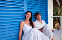 Romantic young couple in tropical beach house Stock Photos