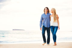 Romantic Young Couple Walking on the Beach Stock Image