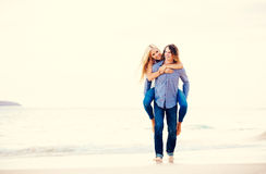 Romantic Young Couple Walking on the Beach Royalty Free Stock Photography