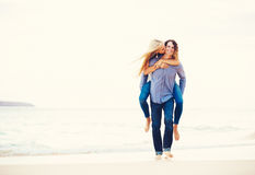 Romantic Young Couple Walking on the Beach Stock Images