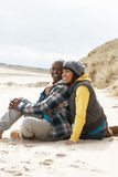 Romantic Young Couple On Winter Beach Stock Photos