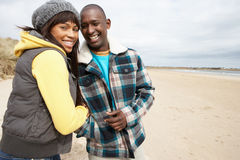 Romantic Young Couple On Winter Beach Stock Photo