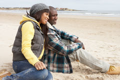 Romantic Young Couple On Winter Beach Royalty Free Stock Photography