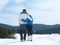 Romantic young couple on winter vacation. Portrait of happy young romantic tourist  couple outdoor in nature at winter vacation Stock Image