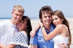 Romantic young couples enjoying vacation Stock Photos