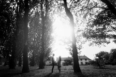 Romantic young family, husband and wife holding hands in sunlit stock photos