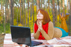 Romantic young girl with laptop in the wood Stock Photo