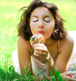 Romantic young girl laying in nature Stock Photos