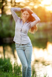 Romantic young girl outdoors enjoying nature Beautiful Model in Stock Images