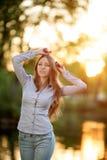 Romantic young girl outdoors enjoying nature Beautiful Model in Royalty Free Stock Photos