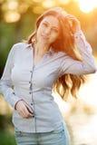 Romantic young girl outdoors enjoying nature Beautiful Model in Stock Photo